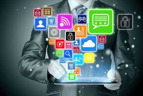 man in suit torso shot with tablet with social media icons comming out of the screen