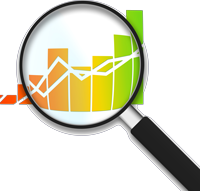 magnifying glass over a graph of showing growth