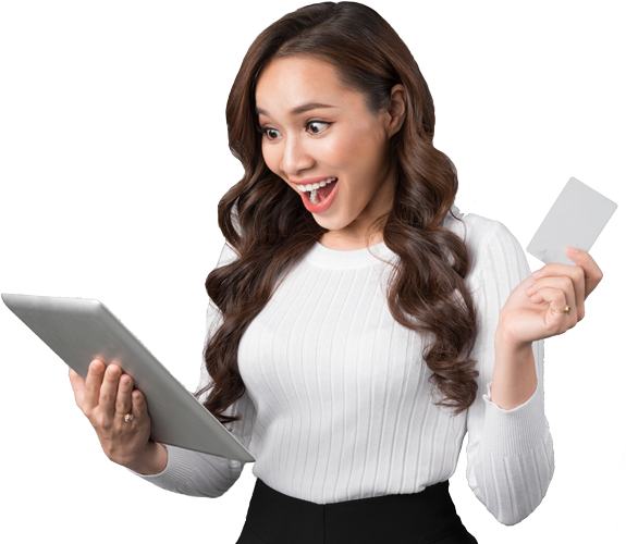 woman with tablet, and credit card with her mouth open and impressed expression